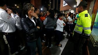 People stand outside the Andino shopping center after an explosive device detonated in a restroom, in Bogota, Colombia June 17, 2017. REUTERS/Jaime Saldarriaga