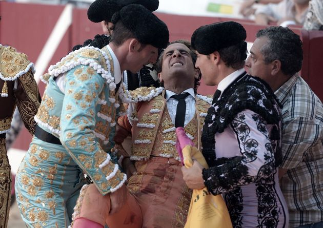 Ivan Fandino is assisted after being impaled by a Baltasar Iban bull during a bullfight at the Corrida...