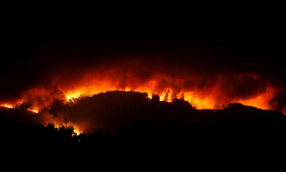 A forest fire is seen near Tojeira, Pedrogao