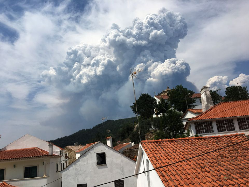 Smoke from a forest fire is seen from the village of Dornes, in central