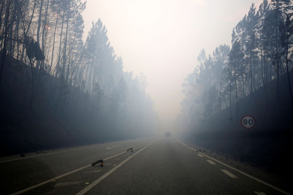 Smoke is seen on the IC8 motorway during a forest fire near Pedrogao