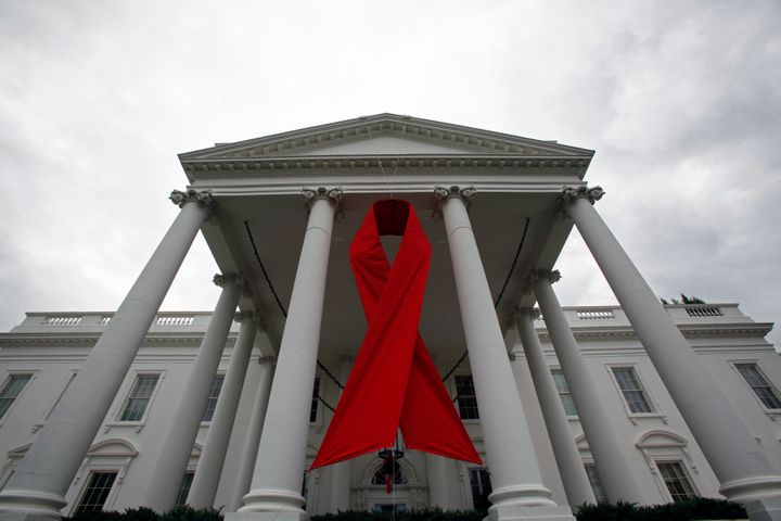 An AIDS ribbon hangs from the North Portico of the White House in recognition of World AIDS Day, November 30, 2010.
