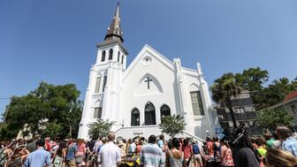 CHARLESTON, UNITED STATES - JUNE 21: People gather in front of the Emanuel AME Church to attend the first mass after the gunman shooting attack, left nine dead on June 21, 2015, in Charleston, South Carolina, USA. (Photo by Cem Ozdel/Anadolu Agency/Getty Images)