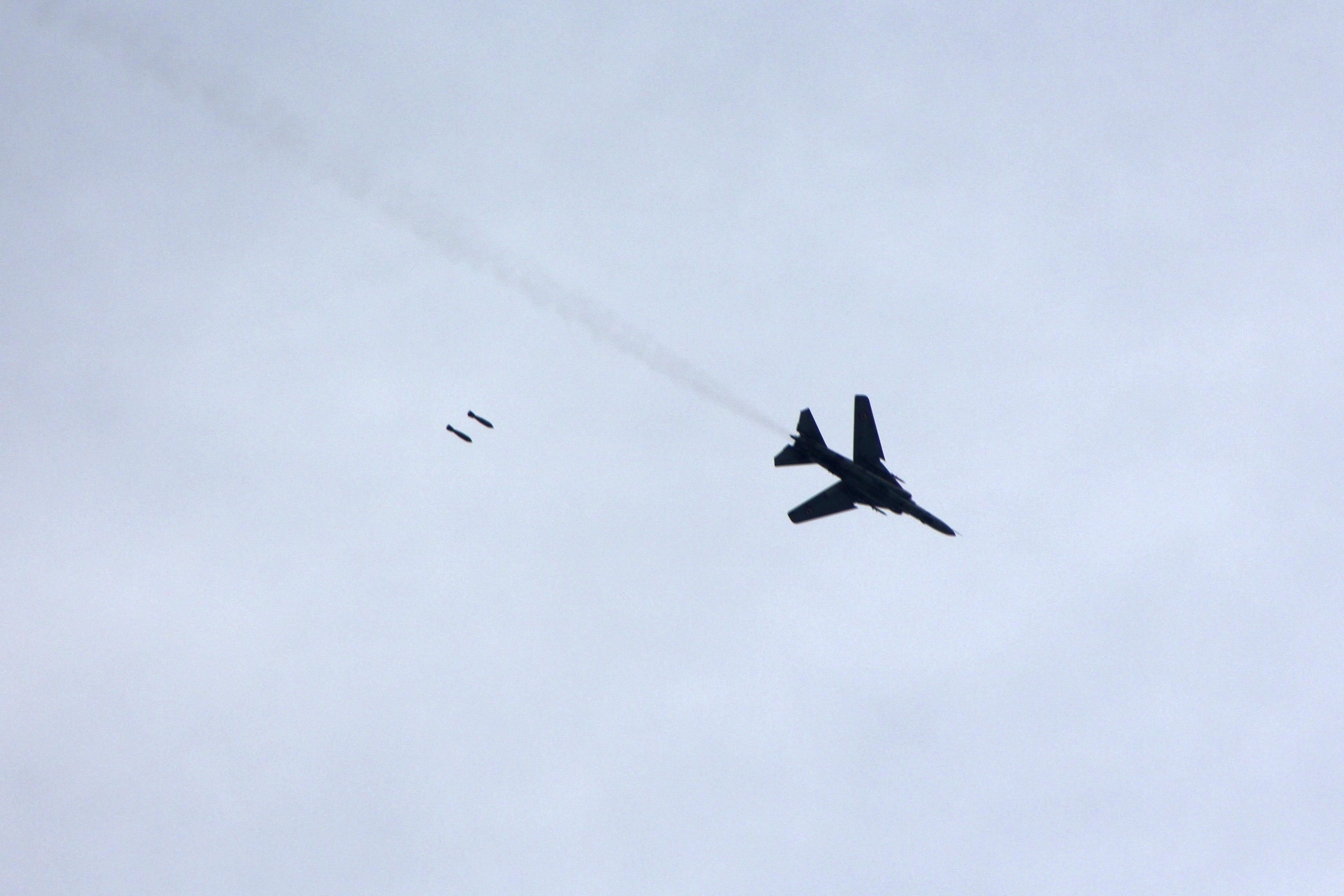 A warplane loyal to Syria's President Bashar al-Assad fires rockets during an air strike in eastern Al-Ghouta.