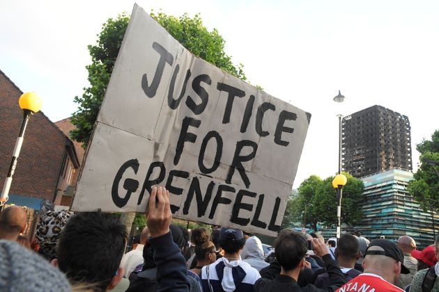Protesters march towards The Grenfell Tower block that was destroyed by