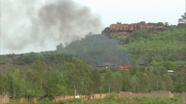 Flames rise following an attack where gunmen stormed Le Campement Kangaba resort in
