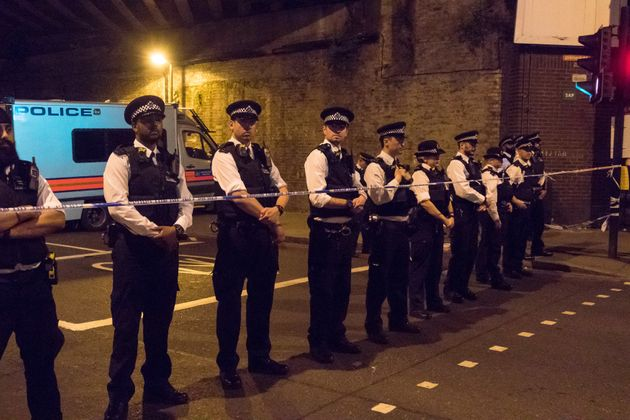 Police officers stand guard near Finsbury Park