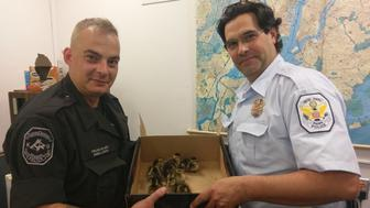 A member of the NYPD and the US Park Service Police show off their nights haul