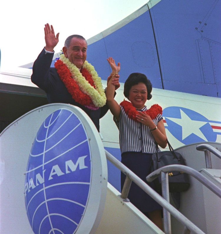 Patsy Mink prepares to board Air Force One with President Johnson on a campaign swing through Hawai'i. Several years later, i