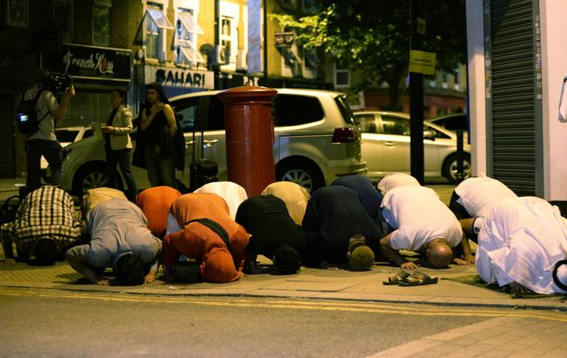 Muslim men pray after the terror attack in Finsbury
