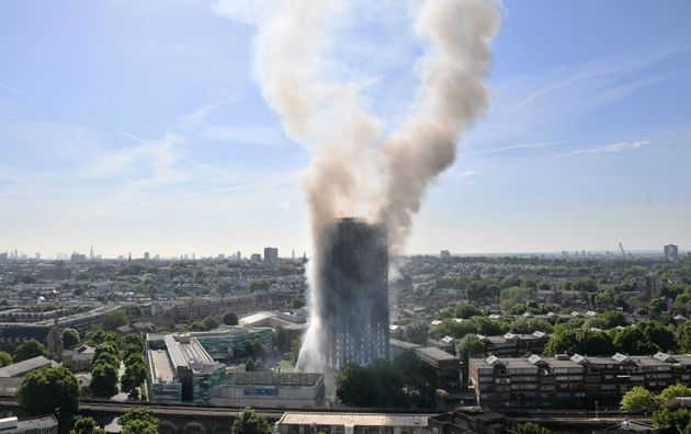 Smoke billows from a fire that has engulfed the 24-storey Grenfell Tower in west