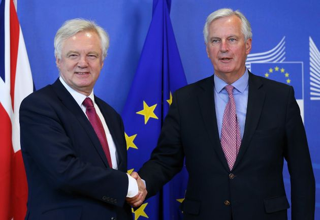 Brexit Secretary David Davis shakes hands with the EU's Chief Negotiator Michel