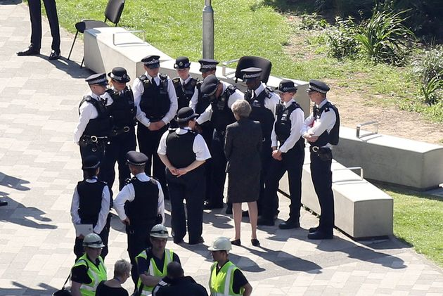 Theresa May meets police near Grenfell Tower last