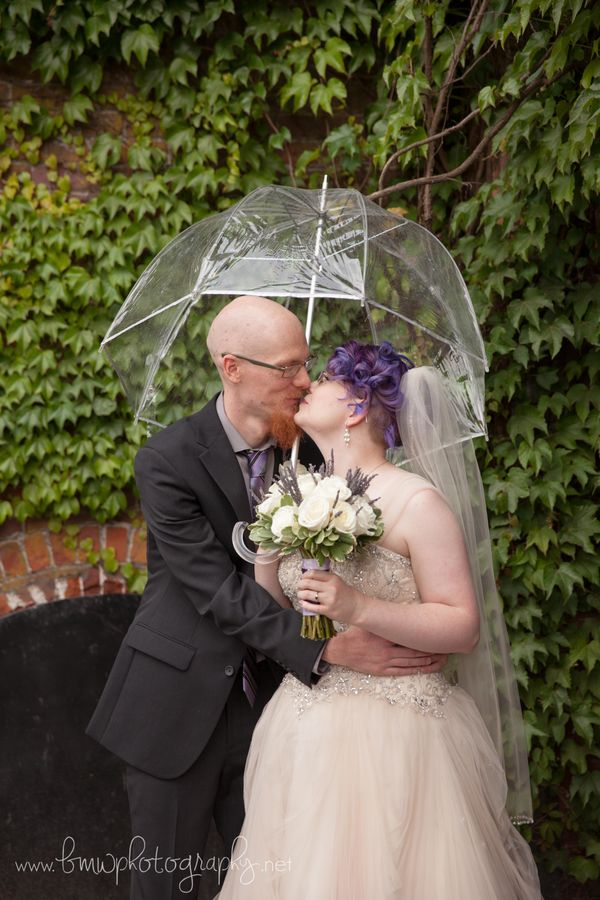 """""""This fun couple didn't let a little rain stop them from having a good time! Congratulations to Anna and Chad, who were marri"""