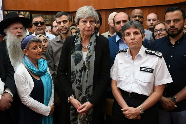 Theresa may and Met Police Commissioner Cressida Dick talk to faith