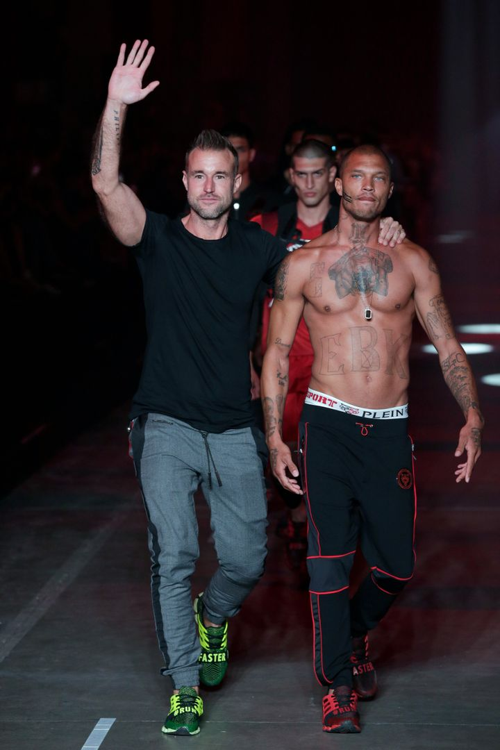 Philipp Plein and Jeremy Meeks walking the runway together.