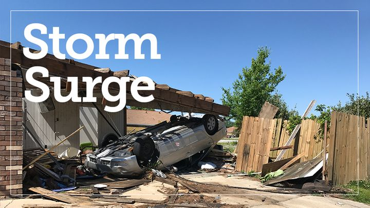 A car remains flipped over in its car port months after a tornado spun through east New Orleans. Climate change and potential