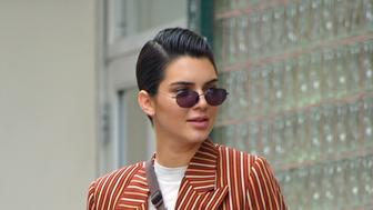 Kendall Jenner wears a modern brown striped suit with white sneakers and her fanny pack while out window shopping at Phillip Lim in NOHO New York City<P>Pictured: Kendall Jenner<B>Ref: SPL1513261  050617  </B><BR/>Picture by: Edward Opi / Splash News<BR/></P><P><B>Splash News and Pictures</B><BR/>Los Angeles:310-821-2666<BR/>New York:212-619-2666<BR/>London:870-934-2666<BR/>photodesk@splashnews.com<BR/></P>