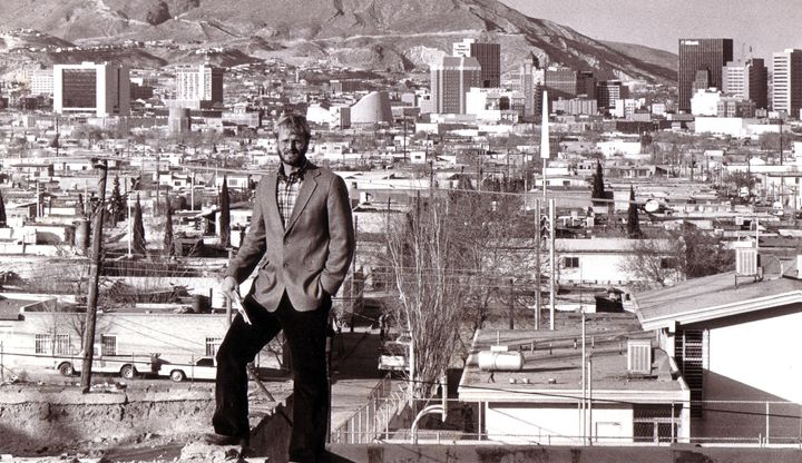 Journalist David M. Hancock seen here in 1986-87, standing on a hill in Ciudad Juarez with downtown El Paso, Texas, in the ba