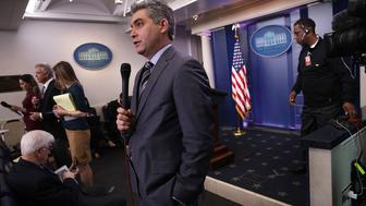 WASHINGTON, DC - FEBRUARY 07:  CNN senior White House correspondent Jim Acosta (C) participates in a stand up shot as he reports after the White House daily briefing at the James Brady Press Briefing Room of the White House February 7, 2017 in Washington, DC. Press Secretary Sean Spicer answered questions from members of the White House press corps on the immigration executive order and repealing Obamacare, among other topics, during the briefing.  (Photo by Alex Wong/Getty Images)