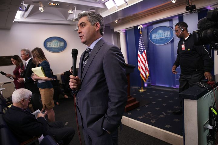 CNN senior White House correspondent Jim Acosta participates in a stand-up shot as he reports after the White House daily bri