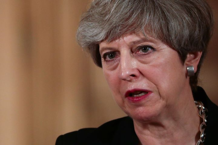 British Prime Minister Theresa May speaks during a news conference in London.