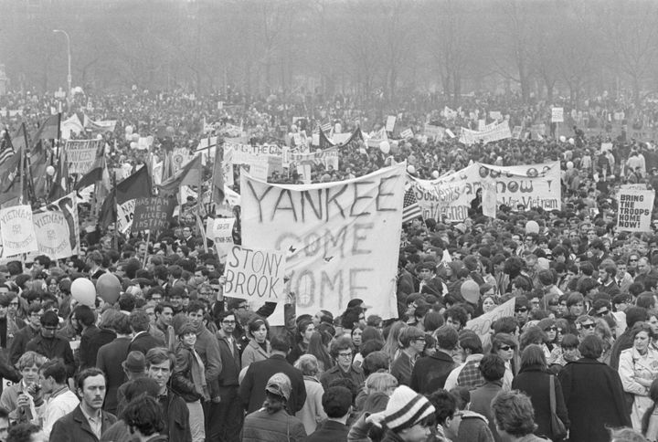 Demonstrators carry banners and signs during a Vietnam War protest in New York's Central Park on April 15, 1967.