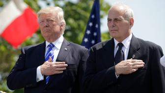President Donald Trump (L) and U.S. Department of Homeland Security Secretary John Kelly hold their hands over their hearts for the U.S. National Anthem as they attend the Coast Guard Academy commencement ceremonies where Trump is addressing the graduating class in New London, Connecticut, U.S. May 17, 2017. REUTERS/Kevin Lamarque
