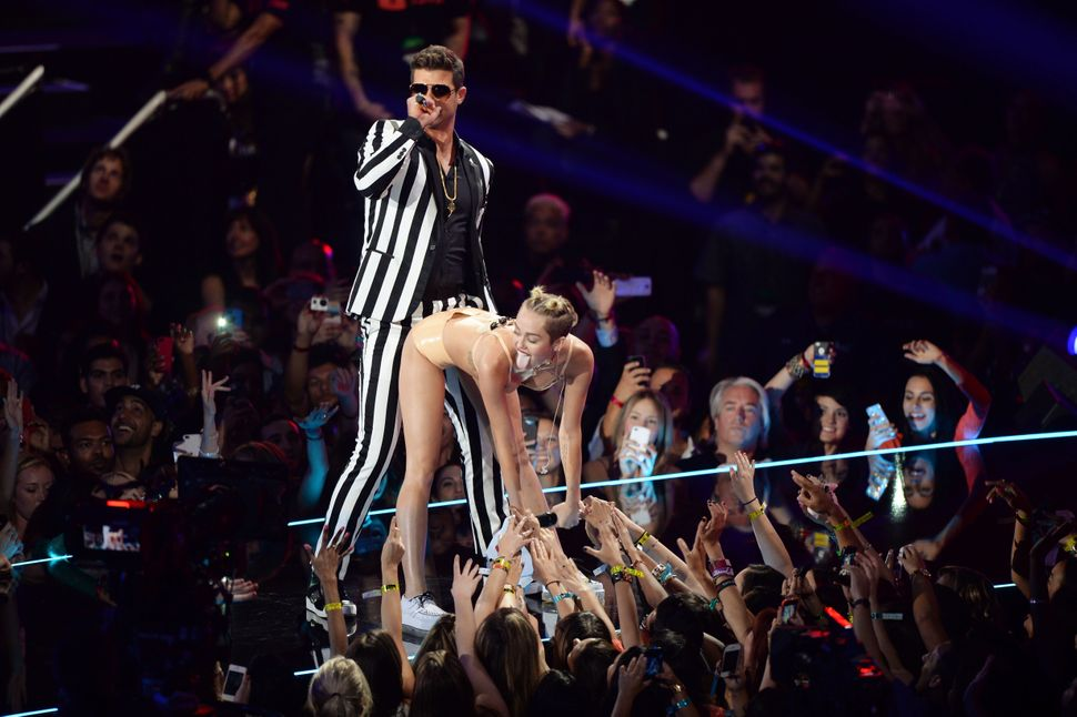 Cyrus performing with Robin Thicke at the 2013 MTV VMAs.