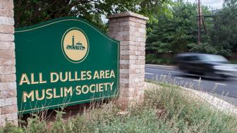 A car drives past the entrance to the All Dulles Area Muslim Society (ADAMS) on June 19, 2017, in Sterling, Virginia. A tight-knit Muslim community in the Virginia suburbs of Washington was grieving after a teenager was apparently assaulted and killed as she left a local mosque. Friends and worshippers at the mosque, known as the All Dulles Area Muslim Society, have identified the teen as 17-year-old Nabra Hassanen of Reston, who had disappeared for several hours Sunday.  / AFP PHOTO / PAUL J. RICHARDS        (Photo credit should read PAUL J. RICHARDS/AFP/Getty Images)