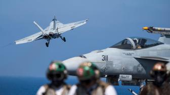 MEDITERRANEAN SEA - JUNE 6:  In this handout provided by the U.S. Navy,  an F/A-18E Super Hornet attached to the 'Tomcatters' of Strike Fighter Squadron (VFA) 31 launches from the flight deck of the Nimitz-class aircraft carrier USS George H.W. Bush (CVN 77)  to conduct flight operations in support of Operation Inherent Resolve June 6, 2017 in the Mediterranean Sea. George H.W. Bush is conducting naval operations in the U.S. 6th Fleet area of operations in support of U.S. national security interests. (U.S. Navy photo by Mass Communication Specialist 2nd Class Christopher Gaines/Released)