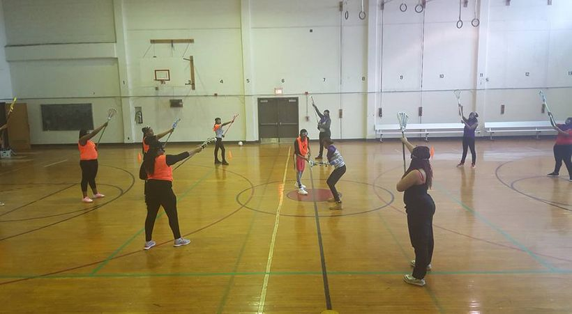 During one of their first practices, Strawberry Mansion High School girl's lacrosse team participants learn the game in the h