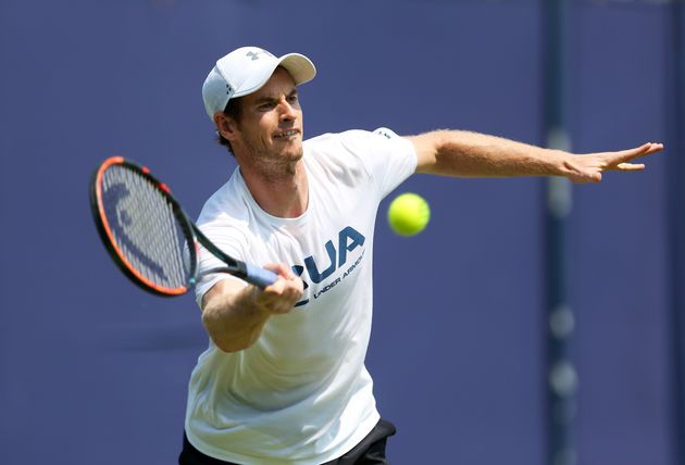 Andy Murray warms up during day one of