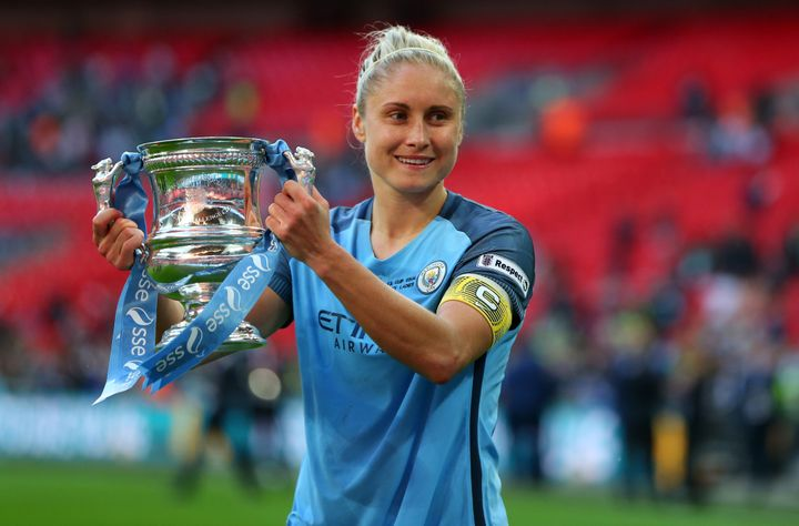 Steph Houghton of Manchester City Women with the trophy during the 2017 SSE Women's FA Cup Final.