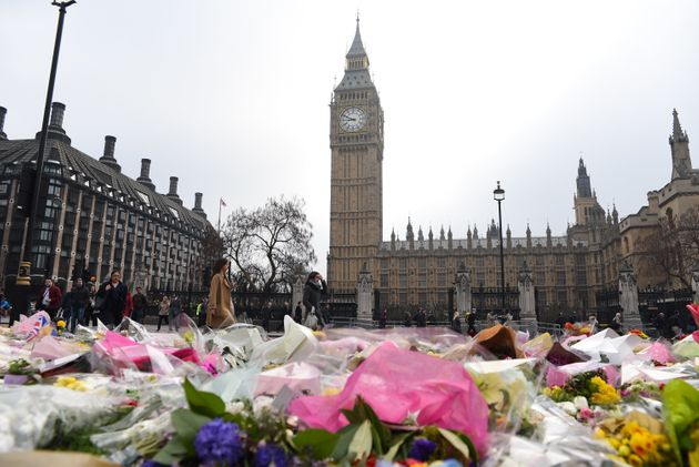 Flowers are left outside the Houses of Parliament in memory of those who died in the Westminster terror