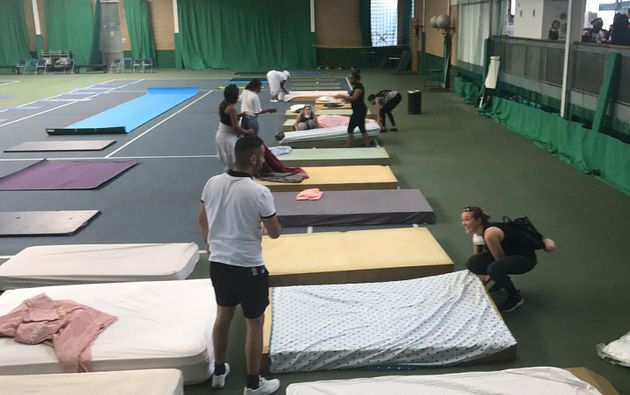 Beds are laid in the Westway Sports Centre shortly after the fire for those made