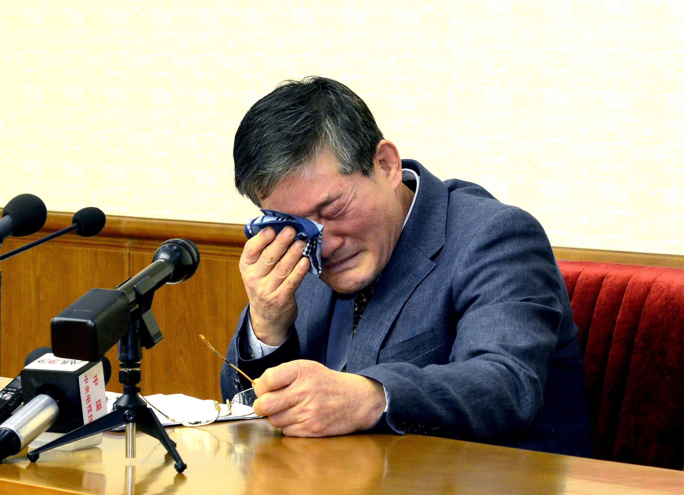 A man who identified himself as Kim Dong-chul attends a news conference in Pyongyang in this undated photo released by North
