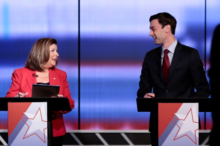 Republican candidate Karen Handel and Democratic candidate Jon Ossoff exchange words at WSB-TV studios in Atlanta on June 6,