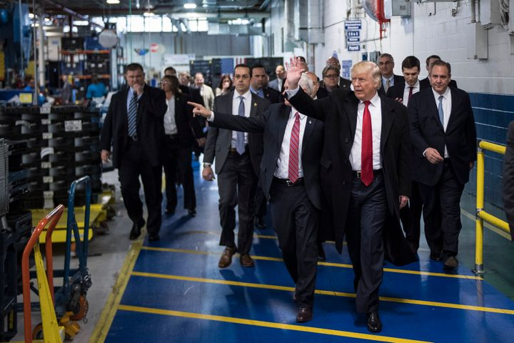 President Donald Trump and Vice President Mike Pence wave as they take a tour of Carrier Corporation in Indianapolis in Decem