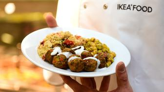 An IKEA employee displays the new IKEA vegetarian meatballs, during a worldwide launch at IKEA Anderlecht, on April 8, 2015. IKEA, who withdrew its signature Swedish meatballs from its markets and cafeterias after one batch was found to contain traces of horse meat in 2013, launched worldwide it's vegetarian meatball in an effort to reduce carbon footprint from animals used to produce some one billion meatballs per year.AFP PHOTO/Emmanuel Dunand        (Photo credit should read EMMANUEL DUNAND/AFP/Getty Images)