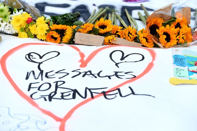 Messages left at a vigil for the victims of the