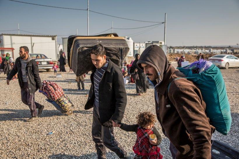 Iraqi families displaced from Mosul arrive at UNHCR's Hasansham camp in Iraqi Kurdistan in January 2017.