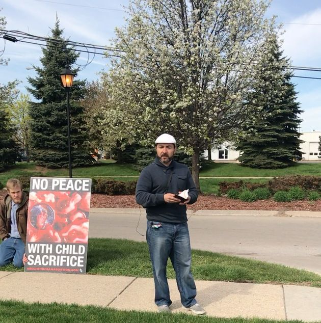 Elvis Kesto, an avid anti-abortion protestor in Michigan, stands outside Northland Family Planning.