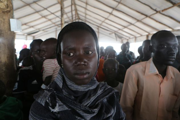 People who fled fighting in South Sudan queue on arrival at Bidi Bidi refugee's resettlement camp...