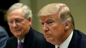 Senate Majority Leader Mitch McConnell (L) sits beside U.S. President Donald Trump during a leadership lunch at the White House in Washington, U.S. March 1, 2017.  REUTERS/Kevin Lamarque