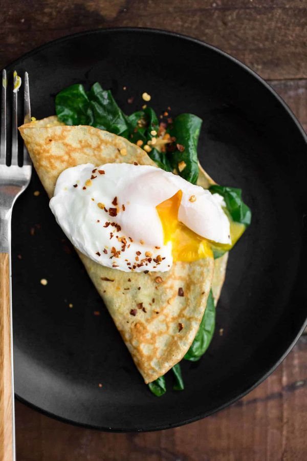 "<strong>Get the <a href=""https://naturallyella.com/garlicky-spinach-cornmeal-crepes/"" target=""_blank"">Garlicky Spinach Cornme"
