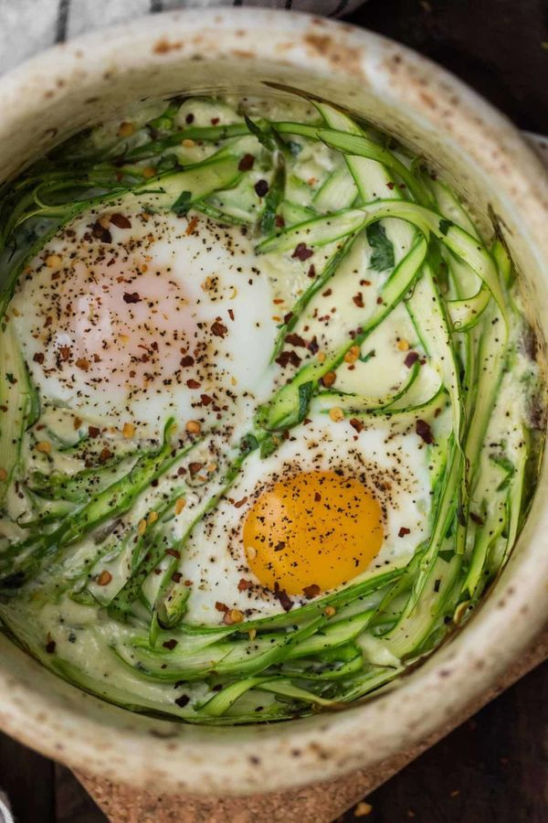 "<strong>Get the <a href=""https://naturallyella.com/asparagus-cream-baked-eggs/"" target=""_blank"">Cream Baked Eggs with Asparag"