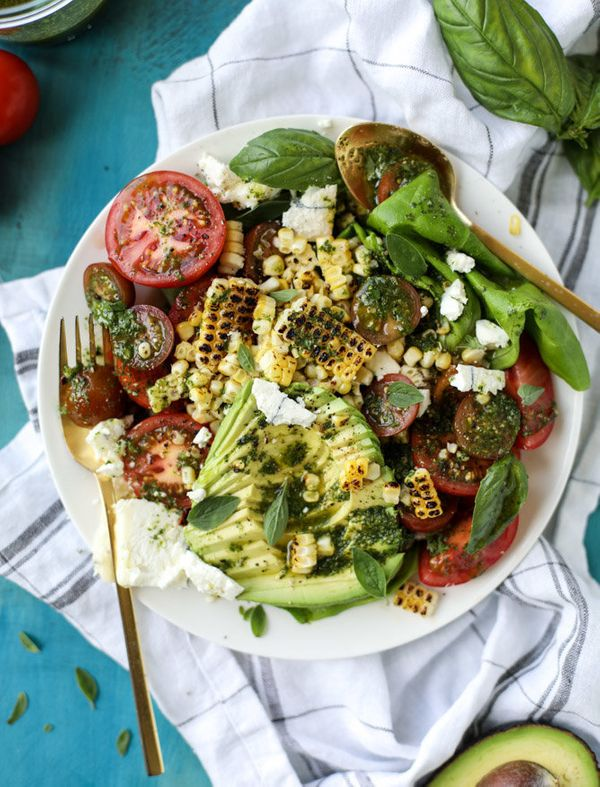 "<strong>Get the <a href=""http://www.howsweeteats.com/2017/06/grilled-corn-tomato-avocado-salad-chimichurri/"" target=""_blank"">"