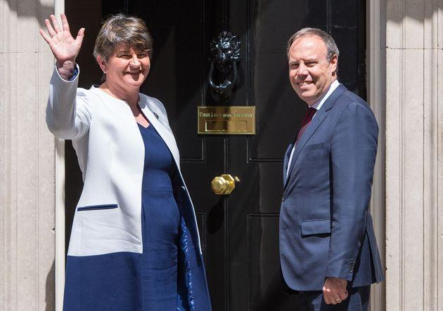 DUP leader Arlene Foster and DUP deputy leader Nigel Dodds arriving at 10 Downing Street in London for...