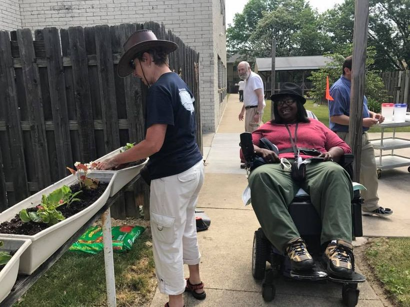 Some volunteer cyclists stopped in Cleveland, OH to plant flower boxes for MS resident, to beautify the space.